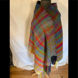Wool fringed plaid wrap with defects.